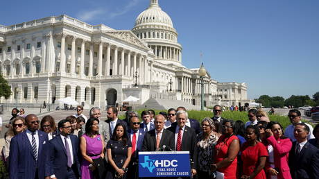 Democrats from the Texas House of Representatives speak in front of the US Capitol in Washington, July 13, 2021.