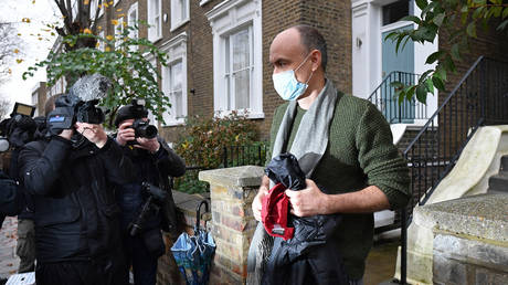 Members of the media surround Number 10 special advisor Dominic Cummings (R) as he leaves his residence in London on November 14, 2020.