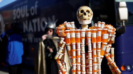 A sculpture made out of opioid pill bottles is set up next to Joe Biden's campaign bus in Somersworth, New Hampshire, US, February 5, 2020.