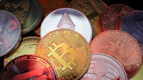 FILE PHOTO: Representations of cryptocurrencies including Bitcoin, Dash, Ethereum, Ripple and Litecoin.