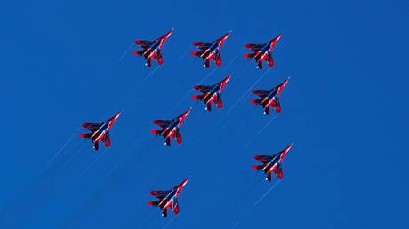 Russian Air Force's Russkiye Vityazi (Russian Knights) aerobatic team perform during an opening of the MAKS 2021 air show in Zhukovsky, outside Moscow, Russia.