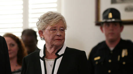 Kay Ivey waits to be sworn in as Alabama's governor