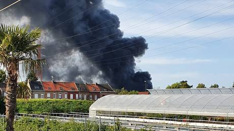 Massive column of smoke visible for MILES as huge fire rages through warehouse in northern France (VIDEOS) - rt