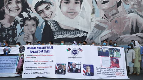 Former interpreters for US troops in Afghanistan protest outside the US embassy in Kabul, June 25, 2021.