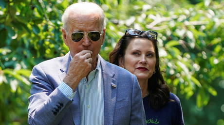 President Joe Biden tours an orchard with Michigan governor and fellow Democrat Gretchen Whitmer, July 3, 2021.
