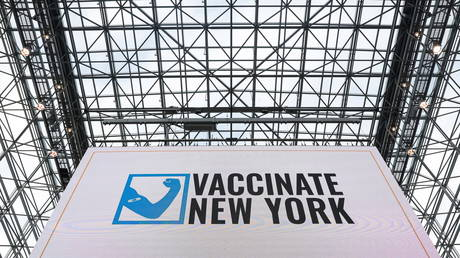 FILE PHOTO: A sign reading 'Vaccinate New York' is seen at an inoculation site at the Jacob K. Javits Convention Center, in New York City, US.