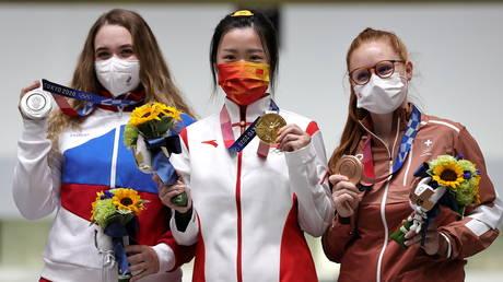 From left: Russia's Anastasiia Galashina, China's Yang Qian, and Nina Christen of Switzerland celebrate on the podium