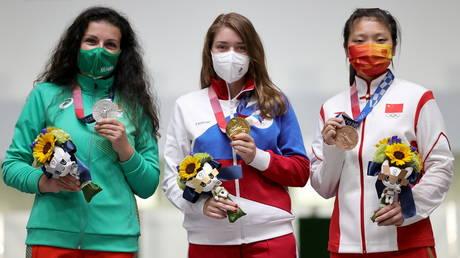 Russia's Vitalina Batsarashkina celebrates with Antoaneta Kostadinova of Bulgaria and Jiang Ranxin of China