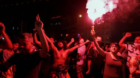 Supporters of Tunisia's President Kais Saied gather on the streets as they celebrate after he dismissed the government and froze parliament, in Tunis, Tunisia, July 25, 2021