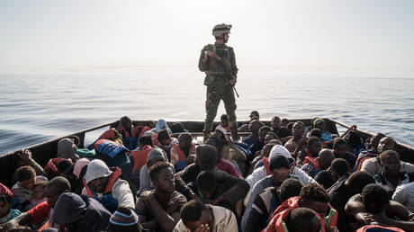 FILE PHOTO. A Libyan coast guardsman stands on a boat during the rescue of 147 illegal immigrants attempting to reach Europe off the coastal town of Zawiyah, 45 kilometres west of the capital Tripoli. © AFP / Taha JAWASHI