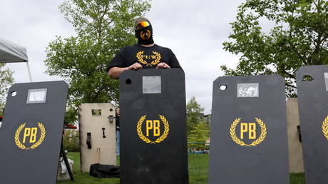 members of Proud Boys listens to speeches during a May Day Second Amendment rally at Riverfront Park in Salem, Oregon