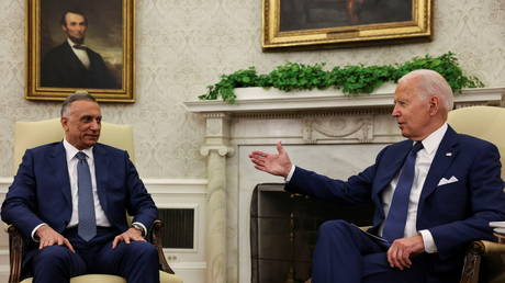 US President Joe Biden speaks with Iraq's Prime Minister Mustafa al-Kadhimi during a bilateral meeting in the Oval Office at the White House, in Washington, DC, July 26, 2021.