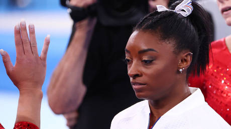 Simone Biles watched on as the US finished second in Tokyo. © Reuters