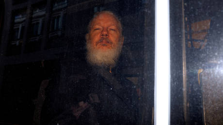 WikiLeaks founder Julian Assange is seen in a police van after he was arrested by British police outside the Ecuadorian embassy, in London, Britain April 11, 2019.
