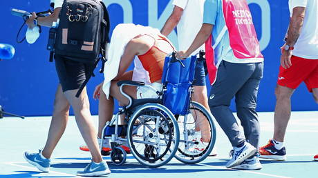 Spanish ace Badosa leaves court in WHEELCHAIR as fears grow for tennis stars in sweltering heat at Tokyo Olympics