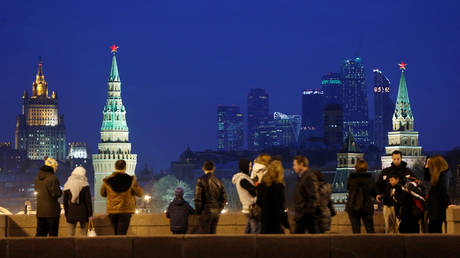 People stand on the Great Moskvoretsky Bridge in central Moscow, Russia, March 28, 2016.