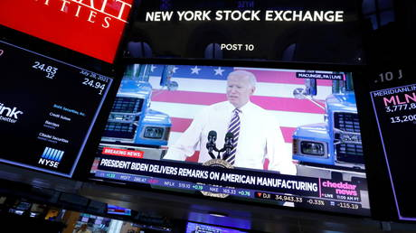A TV screen at the New York Stock Exchange shows US President Joe Biden speaking about American manufacturing, July 28, 2021.