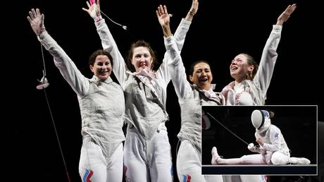 The Russian Olympic Committee (ROC) team celebrated fencing gold in Tokyo. © Reuters