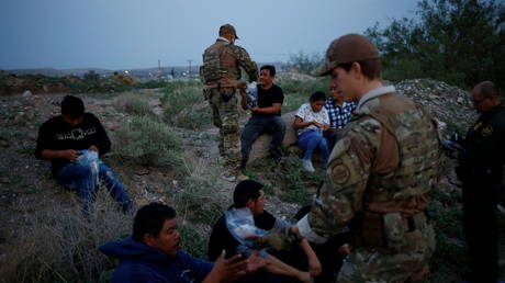 Immigrants are detained by US Border Patrol after crossing into the US from Mexico, in Sunland Park, New Mexico
