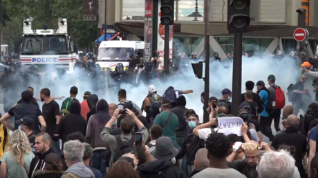 Water cannon v burning barricades: Paris protests against Covid ID turn violent as France resists measure