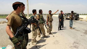 Taliban fighters storm capital of Afghan province, taking over police HQ and sparking mass prison break