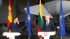 Spanish prime minister forced to break off news conference in Lithuania to let jet take off for urgent mission