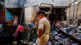 Roadside bombing at Baghdad market kills at least 25 people – reports