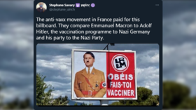 Investigation opened into giant Macron-Hitler billboard comparing Covid policy to Nazi regime