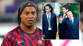 Football ace Ronaldinho admits ex-prime minister Silvio Berlusconi is 'in my heart', brandishes huge bottle of wine on Italy jolly