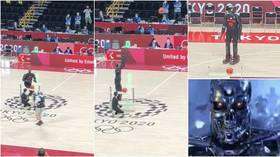 'Humans are gonna get fried': Basketball robot TERRIFIES fans as it lands half-court shot in Olympics display (VIDEO)