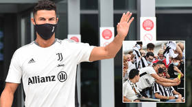 Ron-dezvous: Cristiano Ronaldo mobbed by fans on Juventus return for medical checks after landing by private jet in Turin (PHOTOS)