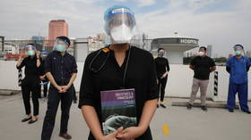 Hundreds of Malaysian contract doctors stage protest for better working conditions as country battles rising Covid infections