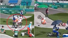 Dutch BMX ace collides with hapless Olympic official who strayed onto track – and star now faces fitness battle to compete (VIDEO)
