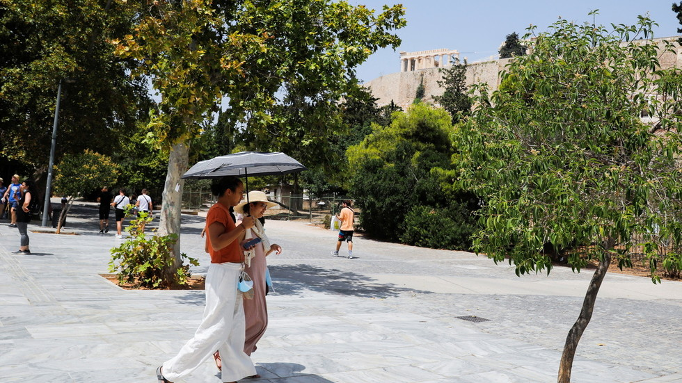 Greek PM calls on citizens to reduce power usage as country bakes in 'worst heatwave since 1987'