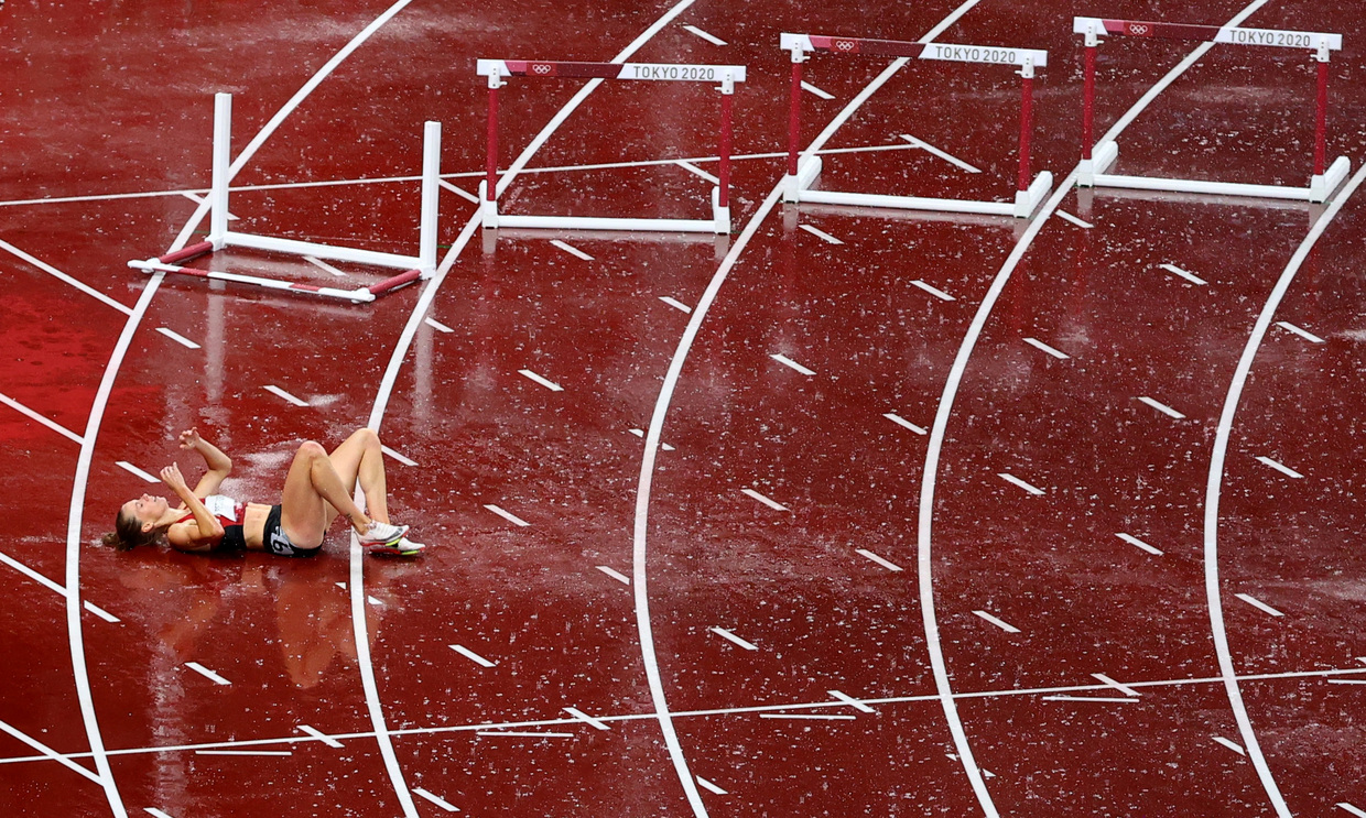 'Selfless sportsmanship': Danish hurdler hailed for congratulating Ukrainian rival after own hopes ended by fall in Tokyo downpour