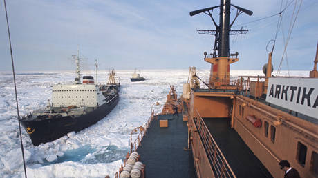Arktika nuclear icebreaker leading a convoy of ships along the Northern Sea Route