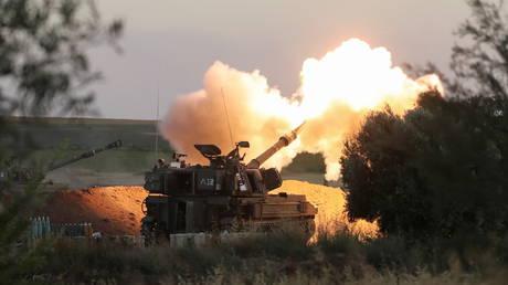FILE PHOTO: Israeli artillery unit at work. © Reuters / Ammar Awad