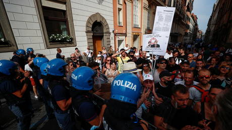 Protesters march as they demonstrate against the Green Pass in Rome, Italy, July 27, 2021.