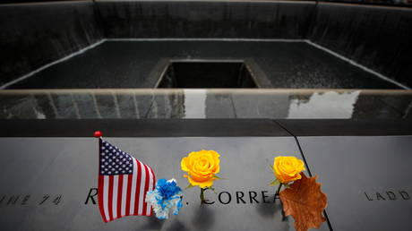 A flag and a flower at the 9/11 Memorial in New York City, November 11, 2020.