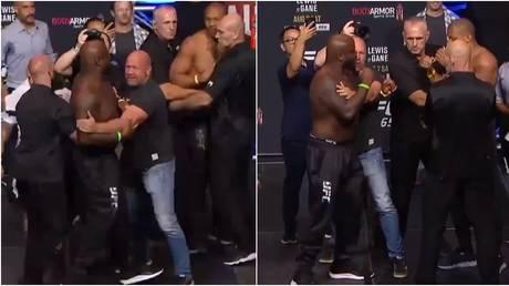 Dana White had to hold back Derrick Lewis at his staredown with Ciryl Gane before UFC 265. © Twitter @ufc