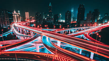Aerial view of road intersection in Shanghai at night.