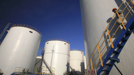 An engineer walks down the stairs of an oil tank at a refinery in Yinchuan, China