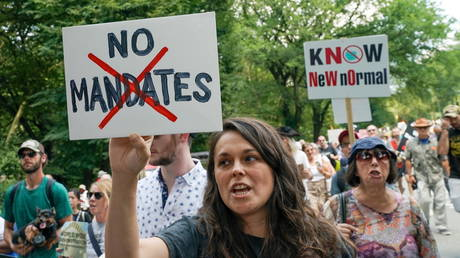 FILE PHOTO: People gather during an anti-vaccine demonstration, amid the Covid-19 pandemic, in Central Park, New York City on July 24, 2021