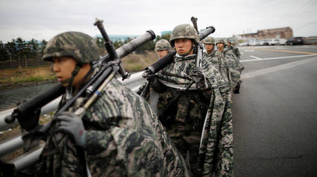 FILE PHOTO: South Korean marines march during a military exercise as a part of annual joint drills with US forces, in Pohang, South Korea, April 5, 2018.