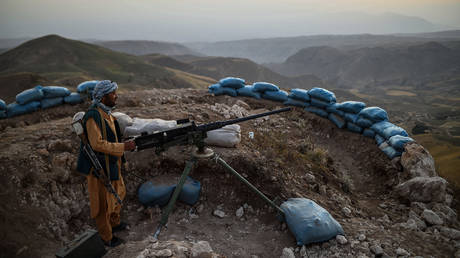 An Afghan militia fighter keeps watch for Taliban insurgents at an outpost in Balkh province, Afghanistan, July 11, 2021.