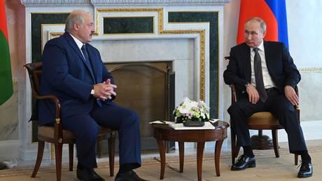 FILE PHOTO. Russian President Vladimir Putin and Belarusian President Alexander Lukashenko talk during their meeting, in St. Petersburg, Russia. © Sputnik