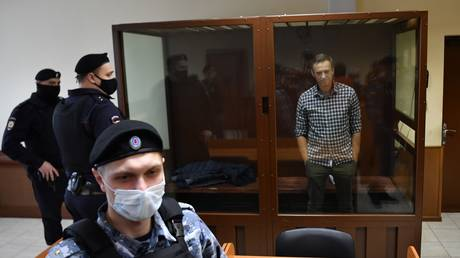 FILE PHOTO. Russian opposition activist Alexey Navalny waits in a courtroom during a hearing on appellation to cancel the decision to replace his suspended sentence in the Yves Rocher fraud case with a real jail term at Babushkinsky Court, in Moscow, Russia. © Sputnik