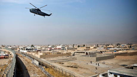 FILE PHOTO: A military helicopter lands at Camp Nathan Smith in Kandahar City, Kandahar Province, Afghanistan.