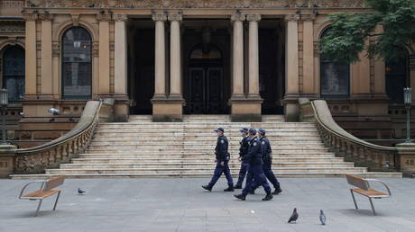Police officers patrol the city center during a law enforcement operation amid the Covid-19 lockdown in Sydney, Australia.
