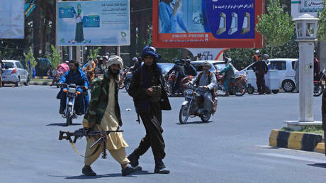 FILE PHOTO. Taliban fighters patrol the streets in Herat on August 14, 2021.